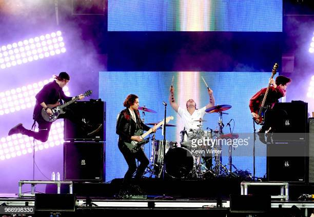 Michael Cliffford Luke Hemmings Ashton Irwin and Calum Hood of the music group 5 Seconds of Summer perform onstage during the 2018 iHeartRadio by ATT...