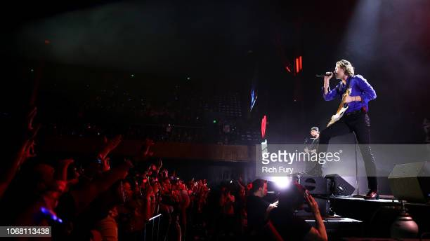 Michael Clifford and Luke Hemmings of 5 Seconds of Summer perform onstage during WiLD 949's FM's Jingle Ball 2018 Presented by Capital One at Bill...