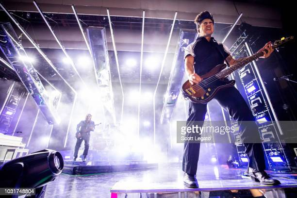 Michael Clifford Ashton Irwin and Calum Hood of 5 Seconds of Summer perform in support of the Meet You There Tour 2018 at Meadow Brook Music Theater...