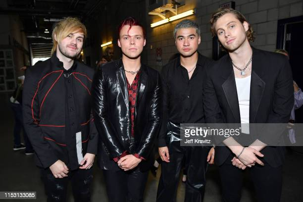 Michael Clifford Ashton Irwin Calum Hood and Luke Hemmings of music group 5 Seconds of Summer attend 2019 iHeartRadio Wango Tango presented by The...