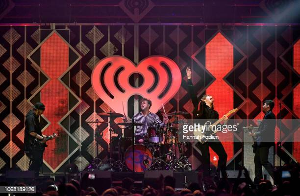 Michael Clifford Ashton Irwin Luke Hemmings and Calum Hood of 5 Seconds of Summer perform onstage during 1013 KDWB's Jingle Ball 2018 at Xcel Energy...