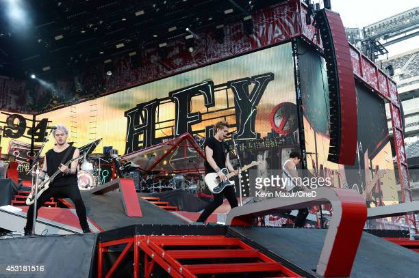 """Michael Clifford, Ashton Irwin, Luke Hemmings, and Calum Hood of 5 Seconds of Summer perform onstage during the """"Where We Are"""" tour at Met Life..."""