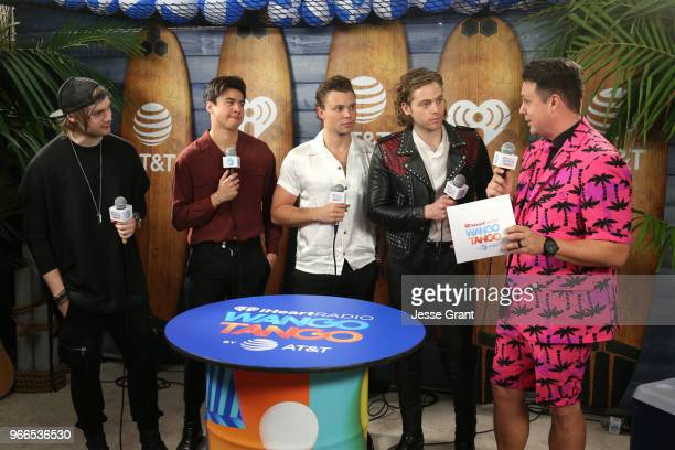 Michael Clifford Calum Hood Ashton Irwin Luke Hemmings of the band 5 Seconds of Summer and Jesse Lozano backstage at the 2018 iHeartRadio Wango Tango...