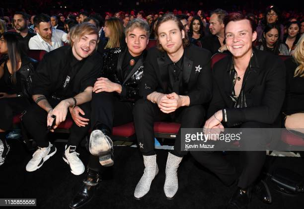 Michael Clifford Calum Hood Luke Hemmings and Ashton Irwin of 5 Seconds of Summer attend the 2019 iHeartRadio Music Awards which broadcasted live on...