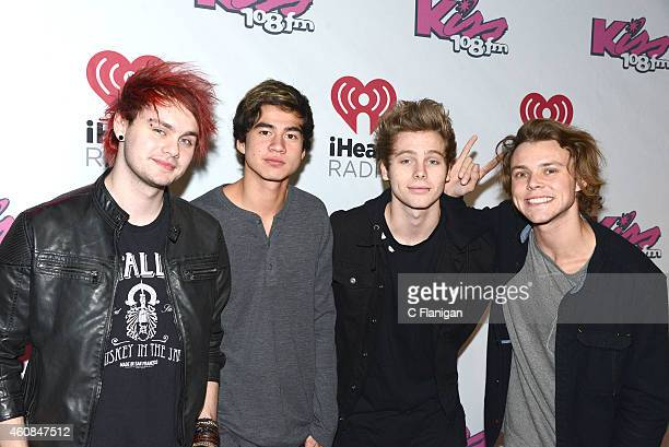 Michael Clifford Calum Hood Luke Hemmings and Ashton Irwin of 5 Seconds of Summer attend Kiss 108's Jingle Ball 2014 at TD Garden on December 14 2014...