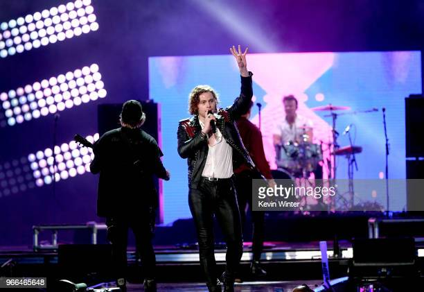 Michael Clifford Luke Hemmings and Ashton Irwin of music group 5 Seconds of Summer perform onstage during the 2018 iHeartRadio Wango Tango by ATT at...