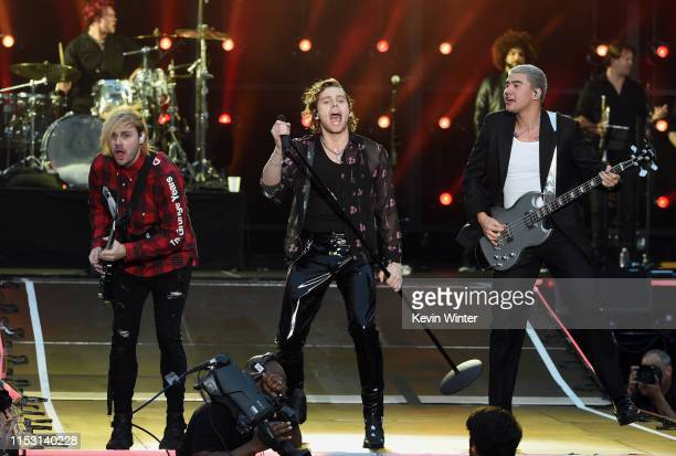 Michael Clifford, Luke Hemmings and Calum Hood of 5 Seconds of Summer perform onstage at 2019 iHeartRadio Wango Tango presented by The JUVÉDERM®...