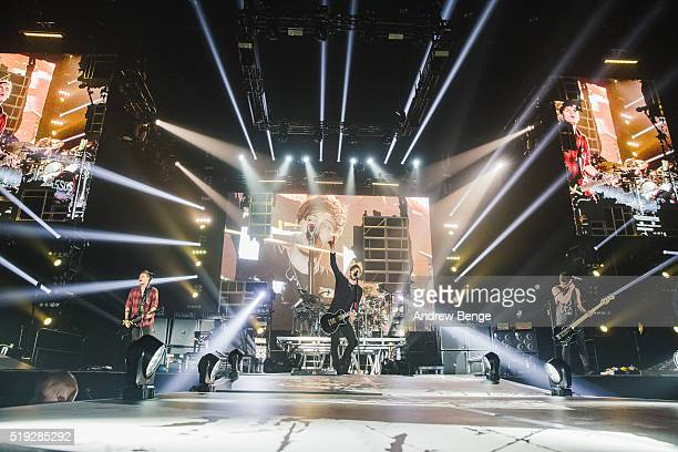 Michael Clifford Luke Hemmings and Calum Hood of 5 Seconds Of Summer perform on stage at Sheffield Arena on April 5 2016 in Sheffield England