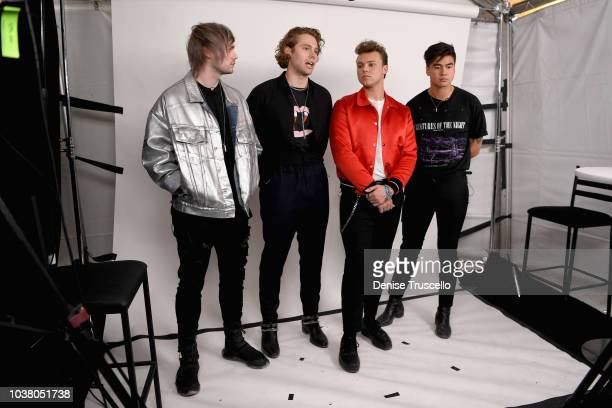Michael Clifford Luke Hemmings Ashton Irwin and Calum Hood of 5 Seconds of Summer pose backstage during the 2018 iHeartRadio Music Festival Daytime...
