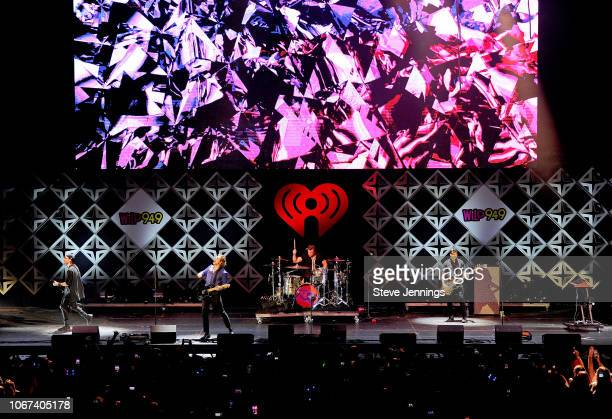 Michael Clifford Luke Hemmings Ashton Irwin and Calum Hood of 5 Seconds of Summer perform onstage during WiLD 949's FM's Jingle Ball 2018 Presented...