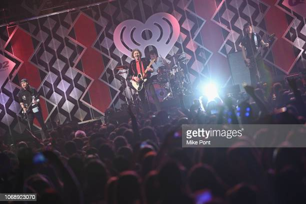 Michael Clifford Luke Hemmings Ashton Irwin and Calum Hood of 5 Seconds of Summer perform onstage during Q102's Jingle Ball 2018 at Wells Fargo...