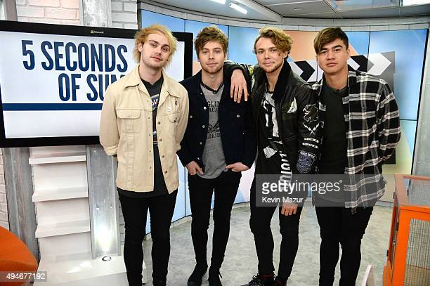 Michael Clifford Luke Hemmings Ashton Irwin and Calum Hood of 5 Seconds of Summer pose backstage after the Citi Concert Series on TODAY at...