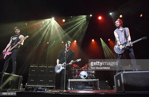 Michael Clifford Luke Hemmings Ashton Irwin and Calum Hood of 5 Seconds of Summer perform during 997 NOW Triple Ho Show 60 at SAP Center on December...