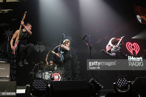 Michael Clifford Luke Hemmings Ashton Irwin and Calum Hood of 5 Seconds of Summer performs during the 2015 Y100 Jingle Ball at BBT Center on December...