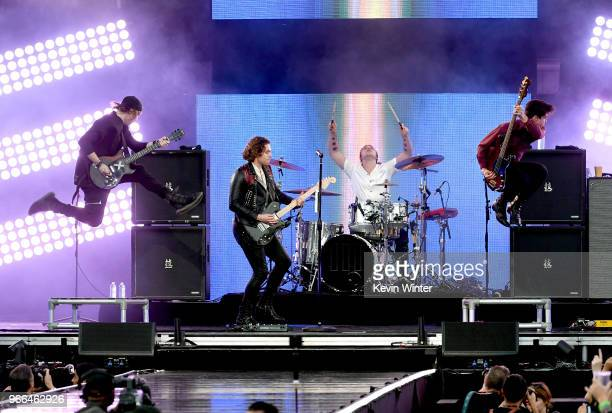 Michael Clifford Luke Hemmings Ashton Irwin and Calum Hood of music group 5 Seconds of Summer perform onstage during the 2018 iHeartRadio Wango Tango...