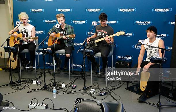 Michael Clifford Luke Hemmings Calum Hood and Ashton Irwin of 5 Seconds of Summer Perform During Their SiriusXM Hits 1 Album Premiere Special at the...