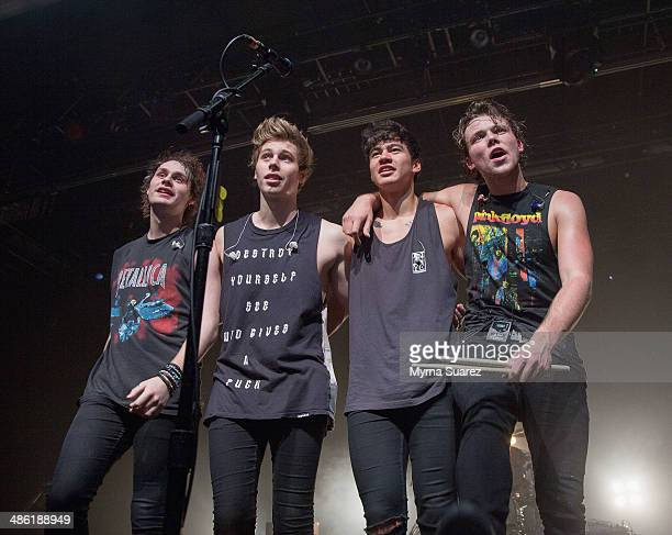 Michael Clifford, Luke Hemmings, Calum Hood, and Ashton Irwin of 5 Seconds Of Summer perform at the Best Buy Theater on April 22, 2014 in New York...