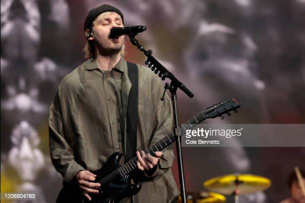 Michael Clifford of 5 Seconds of Summer performs during Fire Fight Australia at ANZ Stadium on February 16, 2020 in Sydney, Australia.