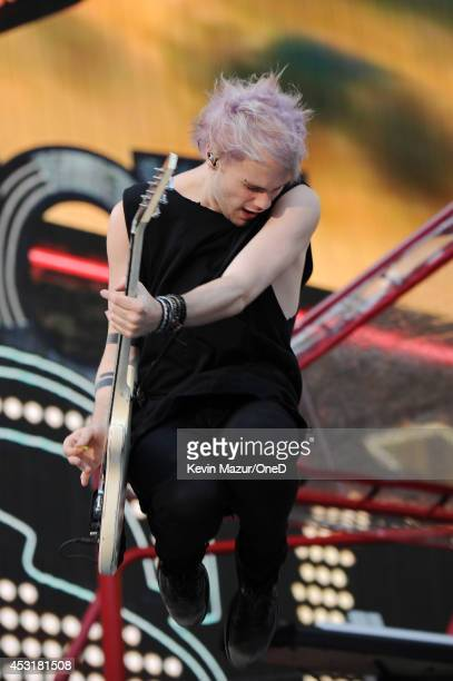 """Michael Clifford of 5 Seconds of Summer performs onstage during the """"Where We Are"""" tour at Met Life Stadium on August 4, 2014 in New York City."""