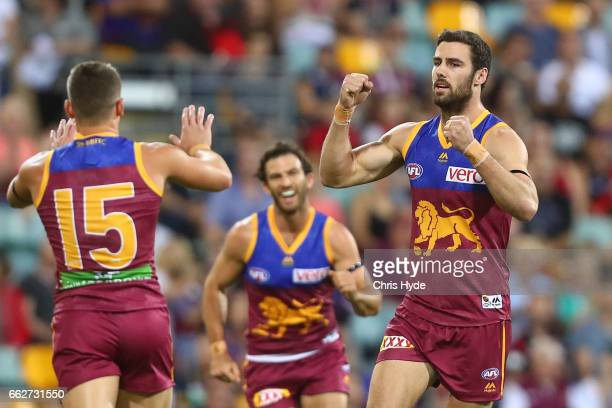 Michael Close of the Lions celebrates a goal during the round two AFL match between the Brisbane Lions and the Essendon Bombers at The Gabba on April...