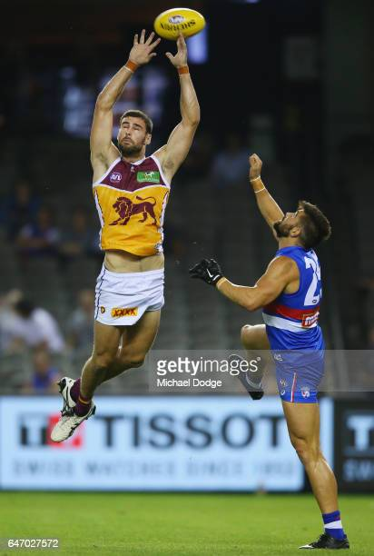 Michael Close of the Lions compete for the ball over Marcus Adams of the Bulldogs during the 2017 JLT Community Series AFL match between the Western...