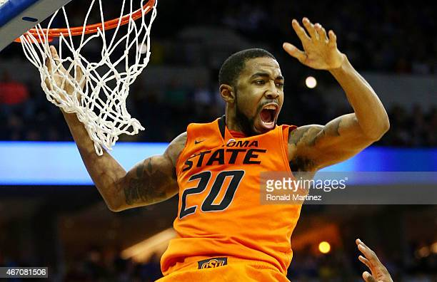 Michael Cobbins of the Oklahoma State Cowboys dunks against the Oregon Ducks in the second half during the second round of the 2015 NCAA Men's...