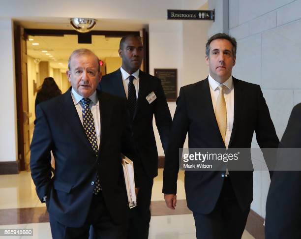 Michael Cohen a personal attorney for President Trump walks with his lawyer Stephen Ryan after appearing before a closed door session of th House...