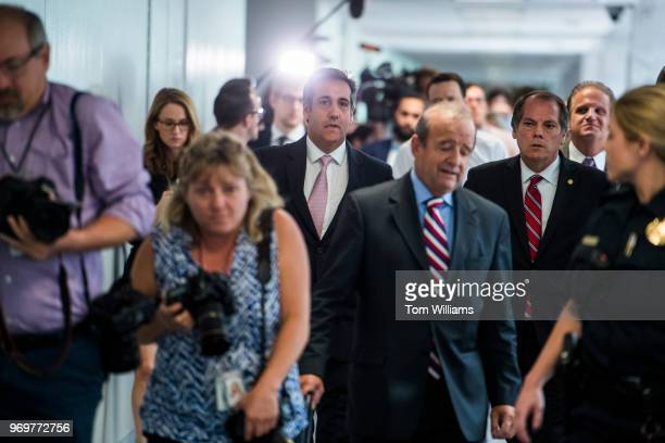 Michael Cohen center a personal attorney for President Trump is escorted by James Wolfe security director for the Senate Intelligence Committee as he...