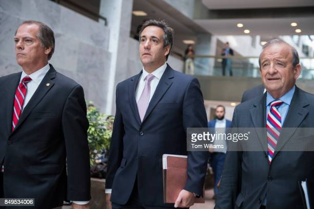 Michael Cohen center a personal attorney for President Trump leaves Hart Building after his meeting with the Senate Intelligence Committee to discuss...