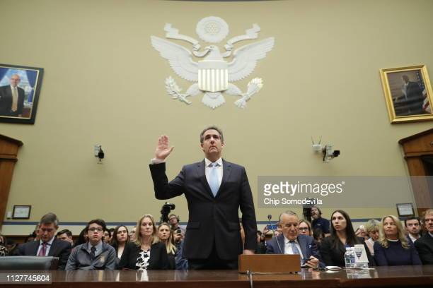 Michael Cohen former attorney and fixer for President Donald Trump is sworn in before testifying before the House Oversight Committee on Capitol Hill...
