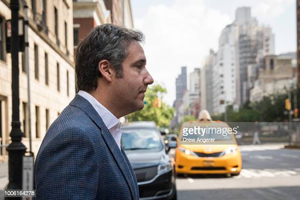 Michael Cohen former personal attorney for US President Donald Trump exits the Loews Regency hotel and walks toward a taxi cab July 27 2018 in New...