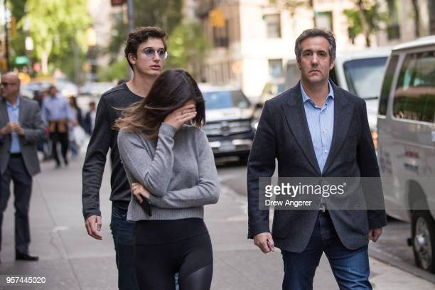 Michael Cohen former personal attorney for US President Donald Trump walks with his children as he exits the Loews Regency Hotel May 11 2018 in New...