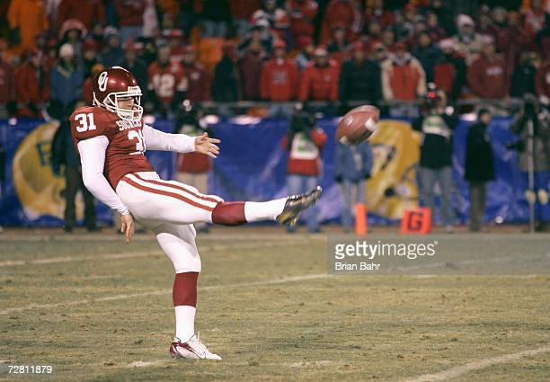 Michael Cohen of the Oklahoma Sooners punts the ball against the Nebraska Cornhuskers during the 2006 Dr Pepper Big 12 Championship on December 2...