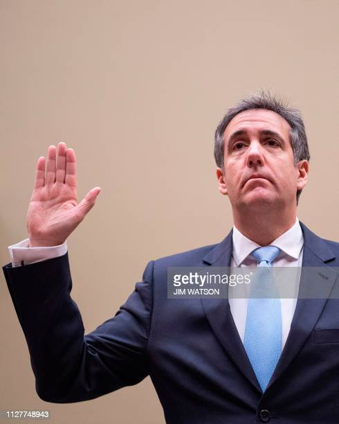 Michael Cohen US President Donald Trump's former personal attorney is sworn in to testify before the House Oversight and Reform Committee in the...