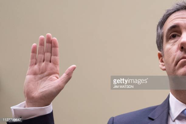 TOPSHOT Michael Cohen US President Donald Trump's former personal attorney is sworn in to testify before the House Oversight and Reform Committee in...
