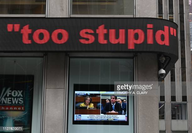 Michael Cohen US President Donald Trump's former personal attorney is seen on the tv at the Fox News Headquarters in the Newscorp Building on 6th...
