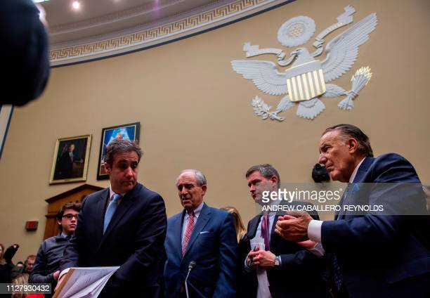 Michael Cohen, US President Donald Trump's former personal attorney, looks on after testifying before the House Oversight and Reform Committee in the...