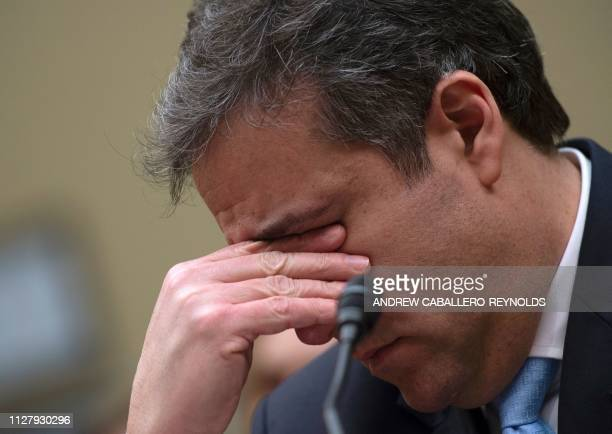 TOPSHOT Michael Cohen US President Donald Trump's former personal attorney ends his testimony before the House Oversight and Reform Committee in the...