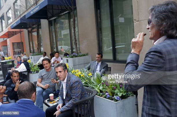 Michael Cohen US President Donald Trump's personal attorney chats with friends near the Loews Regency hotel on Park Ave on April 13 2018 in New York...
