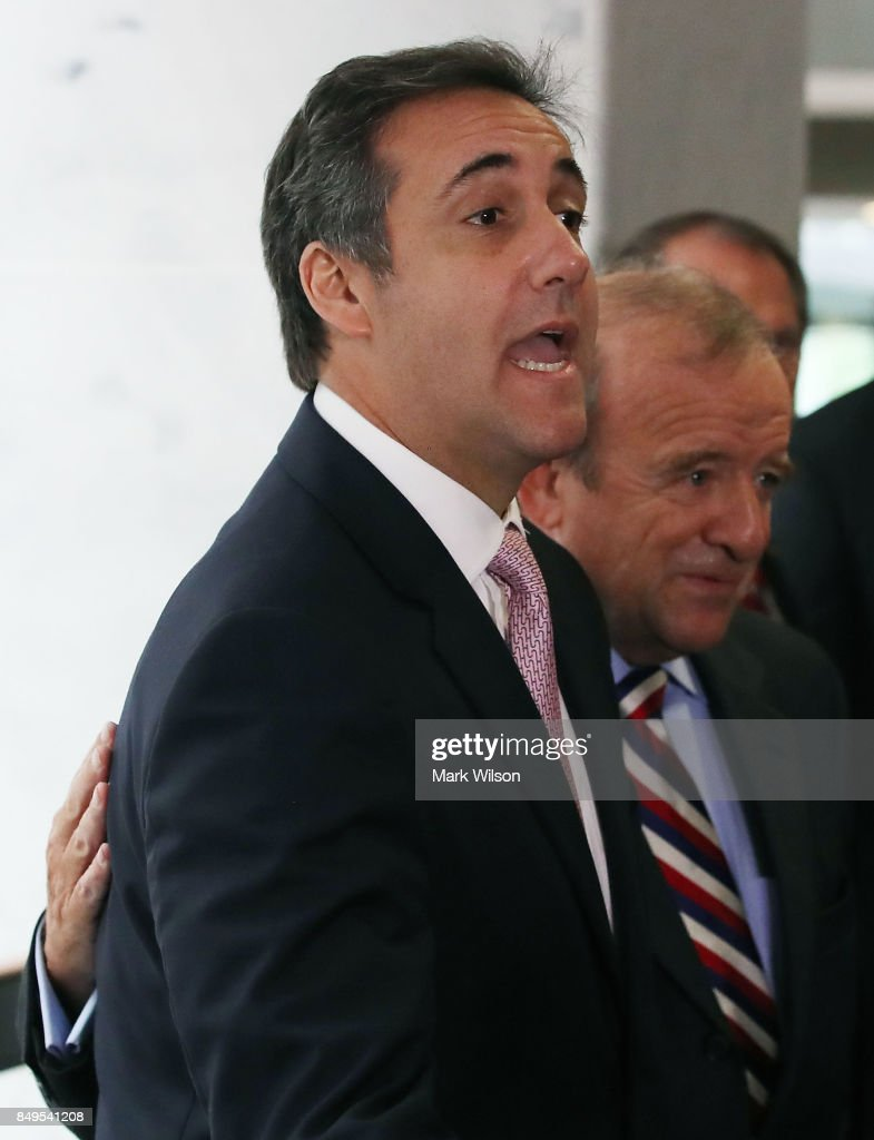 Michael Cohen, U.S. President Donald Trump's personal attorney, stands with his attorney Stephen M. Ryan after finding out the Senate Intelligence Committee hearing at which they were to appear was canceled, on September 19, 2017 in Washington, DC. The committee is investigating alleged Russian interference in the 2016 U.S. presidential election.