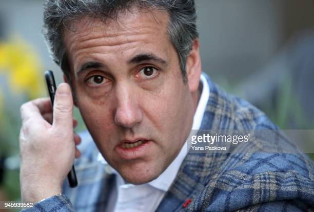 Michael Cohen US President Donald Trump's personal attorney takes a call near the Loews Regency hotel on Park Ave on April 13 2018 in New York City...