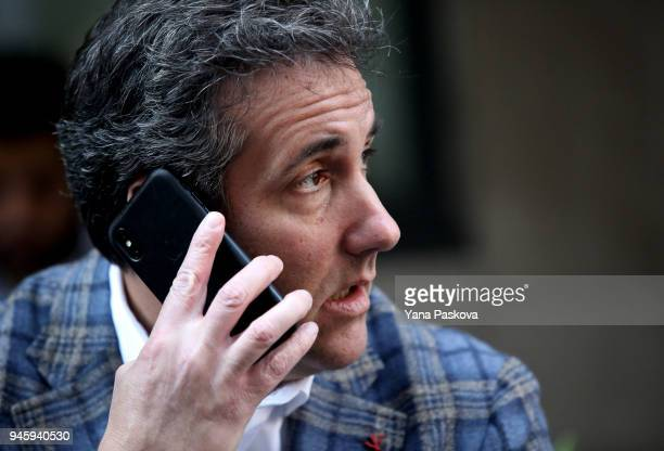 Michael Cohen US President Donald Trump's personal attorney takes a phone call as he sits outside near the Loews Regency hotel on Park Ave on April...