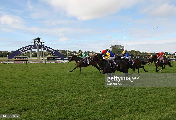 Michael Coleman rides Silk Pins and Opie Bosson rides Warhorse to cross the finish line but awaits an inquiry for first in the Haunui Farm Diamond...