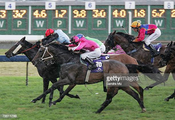 Michael Coleman riding Lady Atire leads Allan Peard riding I'm Isaac up the home straight in the ABN Amro Salver race during the Auckland Cup Day...