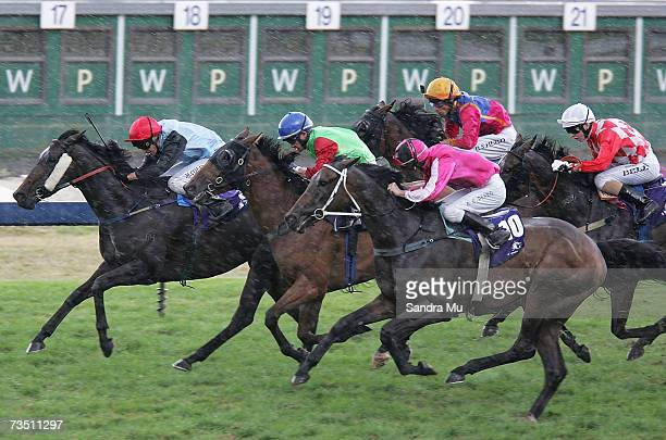 Michael Coleman riding Lady Atire leads Mark Du Plessis riding Waitui Zone and Allan Peard riding I'm Isaac in ABN Amro Salver race during the...