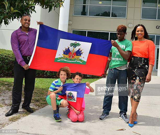 Michael Coles Jax Joseph Nilon Jaid Thomas Nilon Isaiah JeanPierre and Garcelle Beauvais Campaigns For Hillary Clinton on March 12 2016 in Miami...