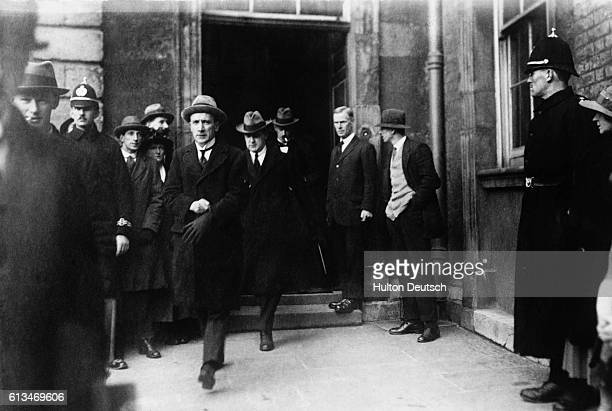Michael Collins, arrives at Dublin Castle, with Sinn Fein staff members, to consolidate the government of Ireland in January 1922. Collins became the...