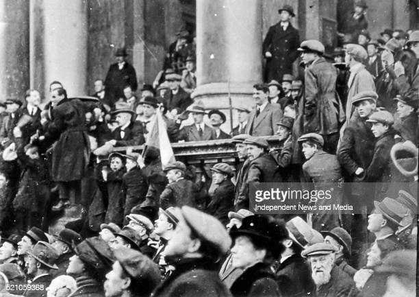 Michael Collins at City hall watching the national Army march past Circa 1919