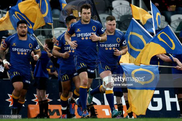 Michael Collins leads Otago out on to the field during the round 4 Mitre 10 Cup match between Otago and Manawatu at Forsyth Barr Stadium on August 30...