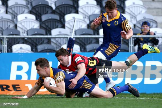Michael Collins of Otago dives over to score a try during the round six Mitre 10 Cup match between Otago and Canterbury at Forsyth Barr Stadium on...